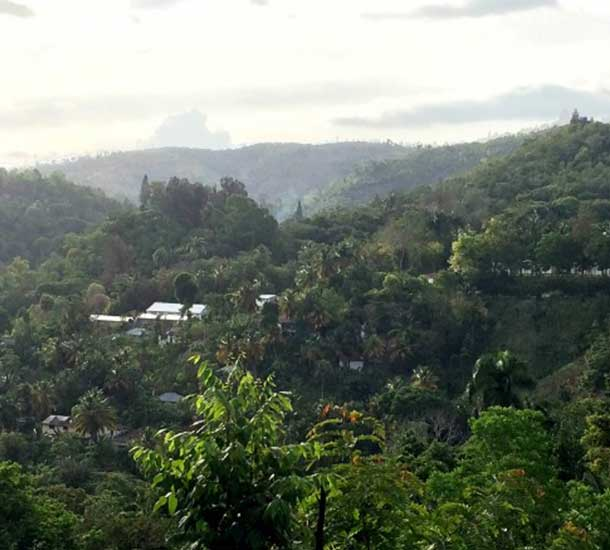 A,Looking across the valley at Hospital Lumiere, located in Bonne Fin, Haiti.