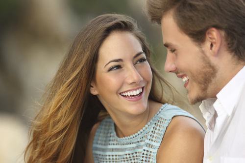 Couple Smiling after getting cosmetic dentistry in Salem, OR at Oak Park Dental.
