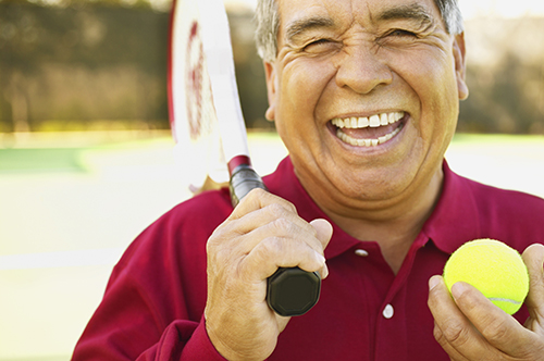 Salem, OR man smiling about his successful root canal procedure by his dentist at Oak Park Dental.